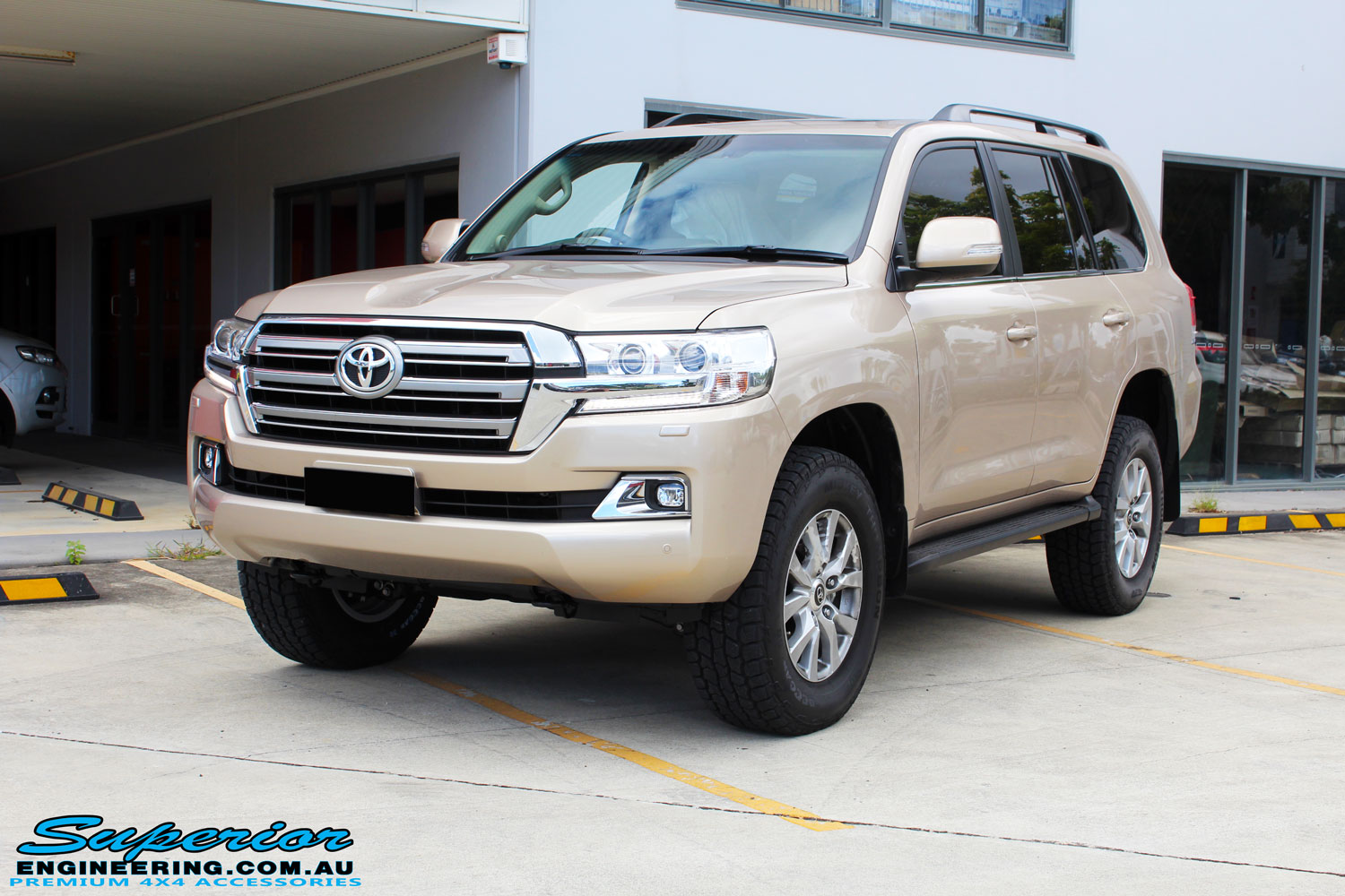 "Right front side view of a Gold Toyota 200 Series Landcruiser after fitment of a 2"" Inch Lift Kit"