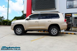 "Right side view of a Gold Toyota 200 Series Landcruiser after fitment of a 2"" Inch Lift Kit"
