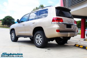 "Rear right view of a Gold Toyota 200 Series Landcruiser after fitment of a 2"" Inch Lift Kit"