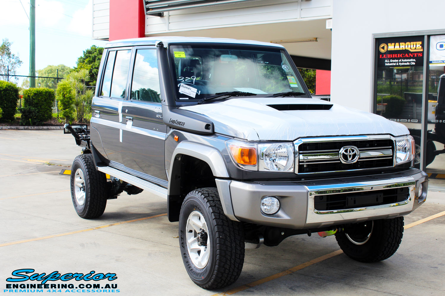 "Right front side view of a Grey Toyota 79 Series Landcruiser after fitment of a Superior Nitro Gas Superflex 4"" Inch Lift Kit"