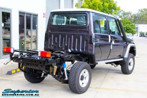 """Rear right view of a Grey Toyota 79 Series Landcruiser after fitment of a Superior Nitro Gas Superflex 4"""" Inch Lift Kit"""