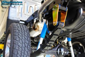 "Rear left underbody view of the fitted Leaf Springs, Nitro Gas 4"" Shocks & Extended Shackle"