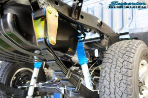 """Rear right underbody view of the fitted Leaf Springs, Nitro Gas 4"""" Shocks & Extended Shackle"""