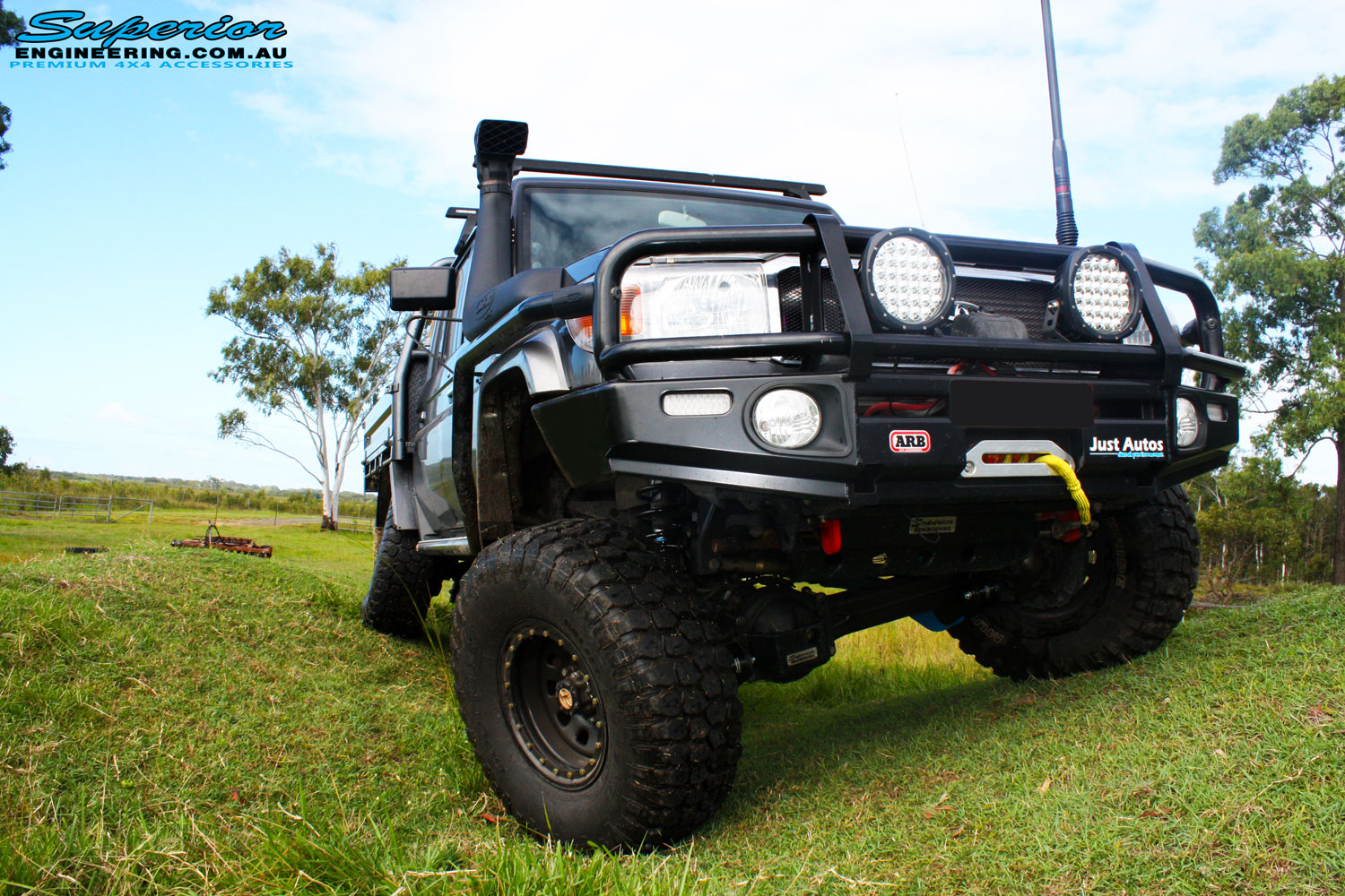 """Front on view of a Grey Toyota 79 Series Landcruiser Dual Cab after fitment of a Superior 4"""" Inch Rear Coil Conversion Kit with Hyperflex Radius Arms."""