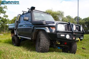 """Front right side view of a Grey Toyota 79 Series Landcruiser Dual Cab after fitment of a Superior 4"""" Inch Rear Coil Conversion Kit and showing off its gear."""