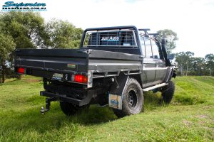 "Rear right side view whilst flexing of a Grey Toyota 79 Series Landcruiser Dual Cab after fitment of a Superior 4"" Inch Rear Coil Conversion Kit."