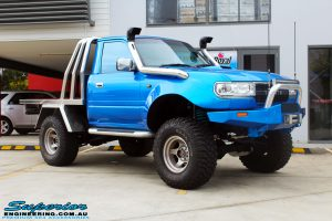 """Right front side view of a Blue Toyota 80 Series Landcruiser Ute Chop before fitment of a Airbag Man 4"""" Inch Coil Air Lift Kit"""