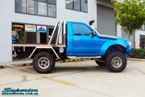 "Side view of a Blue Toyota 80 Series Landcruiser Ute Chop before fitment of a Airbag Man 4"" Inch Coil Air Lift Kit"