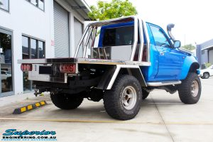 "Rear right view of a Blue Toyota 80 Series Landcruiser Ute Chop before fitment of a Airbag Man 4"" Inch Coil Air Lift Kit"