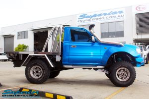 "Side view of a Blue Toyota 80 Series Landcruiser Ute Chop after fitment of a Airbag Man 4"" Inch Coil Air Lift Kit"