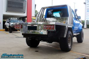 "Rear right view of a Blue Toyota 80 Series Landcruiser Ute Chop after fitment of a Airbag Man 4"" Inch Coil Air Lift Kit"