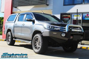 """Right front side view of a Grey Toyota Hilux Revo Dual Cab before fitment of a Superior Remote Reservoir 4"""" Inch Lift Kit"""