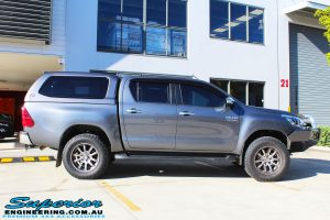 """Side view of a Grey Toyota Hilux Revo Dual Cab before fitment of a Superior Remote Reservoir 4"""" Inch Lift Kit"""