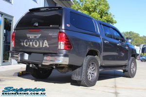 """Rear right view of a Grey Toyota Hilux Revo Dual Cab before fitment of a Superior Remote Reservoir 4"""" Inch Lift Kit"""