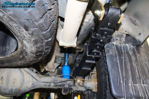 Right rear underbody view of a fitted Superior Remote Reservoir Shock with Leaf Spring