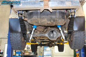 Rear underbody view of 2 fitted Superior Nitro Gas Shocks with Leaf Springs