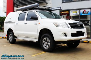 """Right front side view of a Toyota Vigo Hilux Dual Cab before fitment of a Superior Remote Reservoir 2"""" Inch Lift Kit, Ironman 4x4 Bullbar, Steel Side Steps, Snorkel & Engine Diff Guard with Rated Recovery Point"""