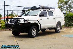 """Left front side view of a Toyota Vigo Hilux Dual Cab after fitment of a Superior Remote Reservoir 2"""" Inch Lift Kit, Ironman 4x4 Bullbar, Steel Side Steps, Snorkel & Engine Diff Guard with Rated Recovery Point"""