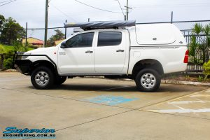 "Side view of a Toyota Vigo Hilux Dual Cab after fitment of a Superior Remote Reservoir 2"" Inch Lift Kit, Ironman 4x4 Bullbar, Steel Side Steps, Snorkel & Engine Diff Guard with Rated Recovery Point"