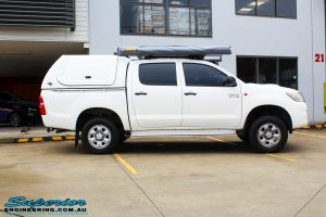 "Side view of a Toyota Vigo Hilux Dual Cab before fitment of a Superior Remote Reservoir 2"" Inch Lift Kit, Ironman 4x4 Bullbar, Steel Side Steps, Snorkel & Engine Diff Guard with Rated Recovery Point"