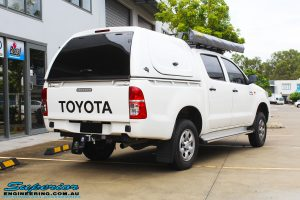 """Rear right view of a Toyota Vigo Hilux Dual Cab before fitment of a Superior Remote Reservoir 2"""" Inch Lift Kit, Ironman 4x4 Bullbar, Steel Side Steps, Snorkel & Engine Diff Guard with Rated Recovery Point"""