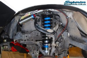 "Left front inside view of the fitted Superior Adjustable Remote Reservoir 2"" Strut with Coil Springs"