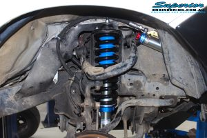 """Right front inside view of the fitted Superior Adjustable Remote Reservoir 2"""" Strut with Coil Springs"""