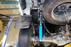 """Rear left underbody view of the fitted Superior Remote Reservoir 2"""" Shock with Leaf Spring, Greaseable Shackle & U-Bolt Kit"""