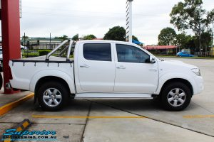 "Right side view of a Toyota Vigo Hilux Dual Cab in White before fitment of a Superior Nitro Gas 2"" Inch Lift Kit"