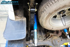 "Rear left underbody view of the fitted fitted Superior Nitro Gas 2"" Shocks with Leaf Springs & Greaseable Rear Shackle"