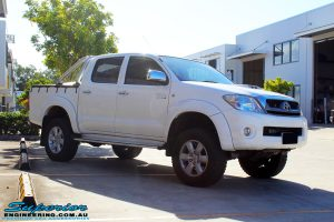 "Right front side view of a Toyota Vigo Hilux Dual Cab in White after fitment of a Superior Nitro Gas 2"" Inch Lift Kit"