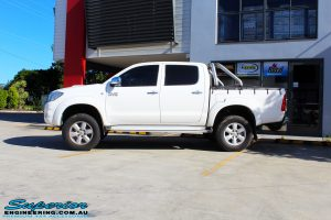 "Left side view of a Toyota Vigo Hilux Dual Cab in White after fitment of a Superior Nitro Gas 2"" Inch Lift Kit"