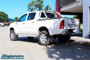 """Rear left view of a Toyota Vigo Hilux Dual Cab in White after fitment of a Superior Nitro Gas 2"""" Inch Lift Kit"""