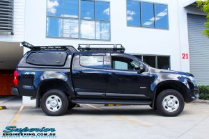 "Right side view of a Black Holden RG Colorado Dual Cab after fitment of a Superior Nitro Gas 2"" Inch Lift Kit"