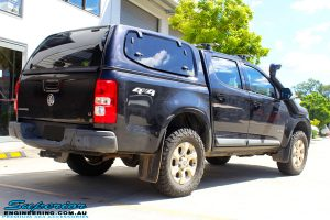 """Rear right view of a Dark Blue Holden RG Colorado Dual Cab before fitment of a Superior Nitro Gas 3"""" Inch Lift Kit"""