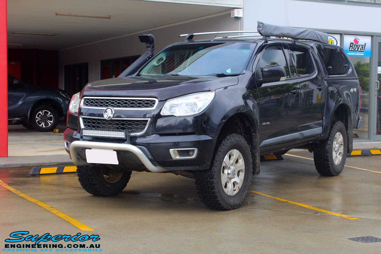 """Left front side view of a Dark Blue Holden RG Colorado Dual Cab after fitment of a Superior Nitro Gas 3"""" Inch Lift Kit"""