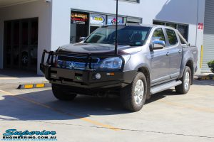 Left front side view of this Holden RG Colorado in Grey after fitment of a Ironman 4x4 Deluxe Black Bull Bar & GME UHF