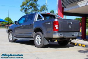 Rear left view of this Holden RG Colorado in Grey after fitment of a Ironman 4x4 Deluxe Black Bull Bar & GME UHF