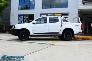 Left side view of a White Holden RG Colorado Dual Cab before fitment of a Tough Dog 40mm Lift Kit