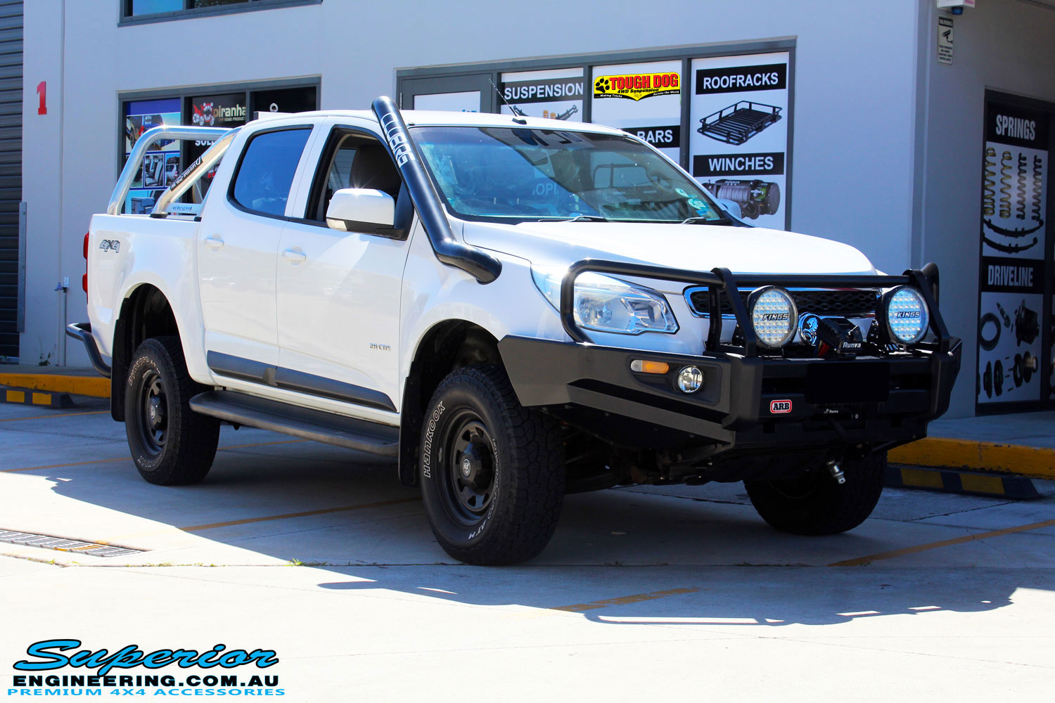 Right front side view of a White Holden RG Colorado Dual Cab after fitment of a Tough Dog 40mm Lift Kit