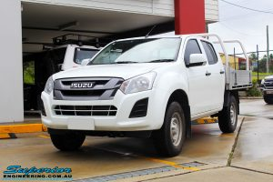 "Left front side view of a White Isuzu D-Max Dual Cab before fitment of a Superior Remote Reservoir 2"" Inch Lift Kit + King Wheels & Nitto Tyres"