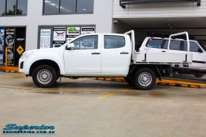 "Left side view of a White Isuzu D-Max Dual Cab before fitment of a Superior Remote Reservoir 2"" Inch Lift Kit + King Wheels & Nitto Tyres"