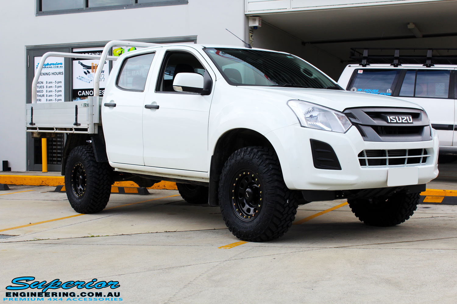 "Right front side view of a White Isuzu D-Max Dual Cab after fitment of a Superior Remote Reservoir 2"" Inch Lift Kit + King Wheels & Nitto Tyres"