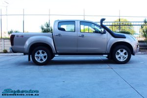 "Right side view of a Silver Isuzu D-Max Dual Cab before fitment of a Superior Nitro Gas 2"" Inch Lift Kit + MCC Rocker Bull Bar + Rear Bar & a Superior Diff Drop Kit"