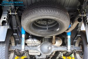 """Rear underbody view of the fitted Superior Nitro Gas 2"""" Shocks + Leaf Springs & U-Bolt Kit"""