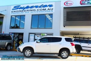 Left side view of a White Isuzu MU-X Wagon before fitment of a quality Bilstein 45mm Lift Kit