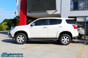 Left side view of a White Isuzu MU-X Wagon after fitment of a quality Bilstein 45mm Lift Kit