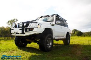 Left front side view of a White Nissan GU Patrol Wagon before fitment of a range of high quality Superior Engineering 4x4 Suspension & Accessories