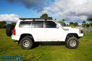 Right side view of a White Nissan GU Patrol Wagon before fitment of a range of high quality Superior Engineering 4x4 Suspension & Accessories