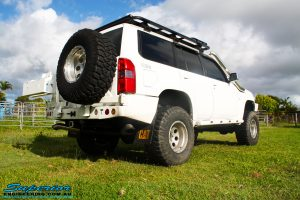 Rear right view of a White Nissan GU Patrol Wagon before fitment of a range of high quality Superior Engineering 4x4 Suspension & Accessories